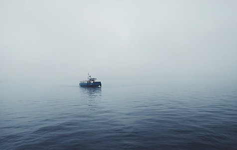 gray boat on body of water