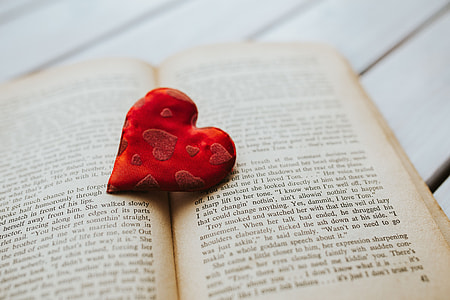 Little red heart with an old book