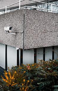 white bullet-type surveillance camera