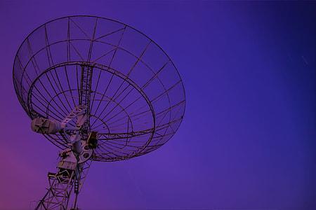 Space satellite and purple sky