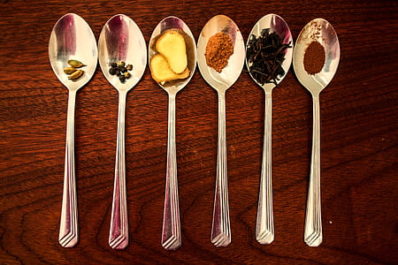 six grey stainless steel spoon with spices