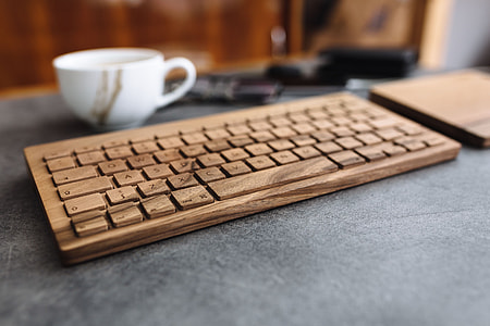 Young man typing on the wooden keyboard