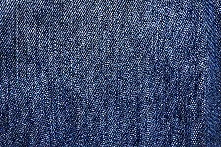 shallow focus photography of blue denim