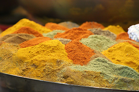 assorted-color spice powders