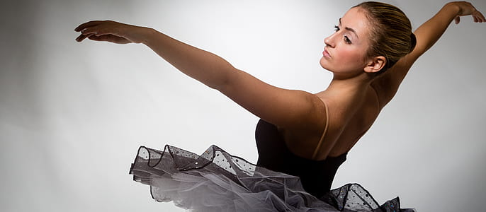 woman wearing black and white ballerina uniform