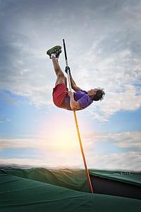 man holding pole bolt
