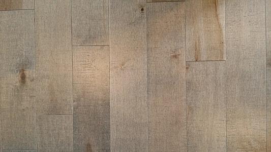 close photo of rectangular brown parquet floor