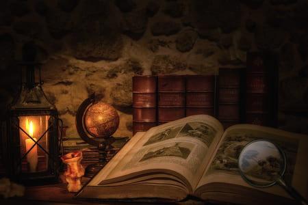 desk globe beside book