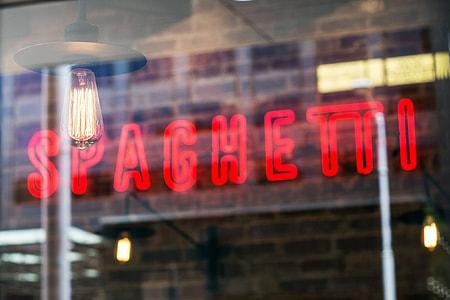 Spaghetti neon light signage turned on