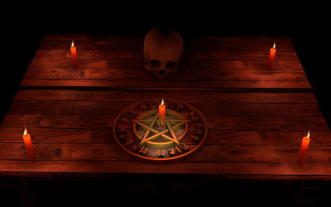 five red candles, brown pentagram, and human skull