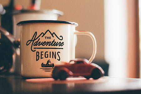 white The Adventure Begins ceramic mug