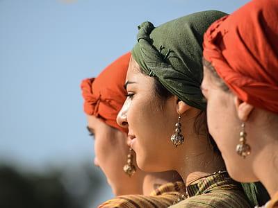 macro shot of women's wearing green hijab veil