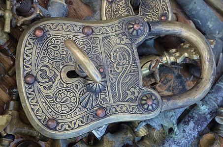 gray metal padlock in closeup photp