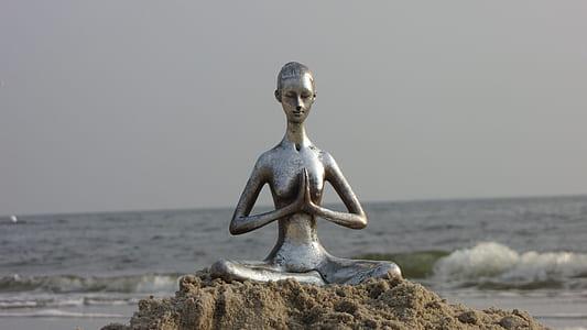 female statue near seashore
