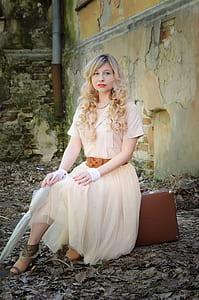 woman wearing beige maxi dress