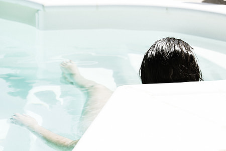 woman lying down on Jacuzzi