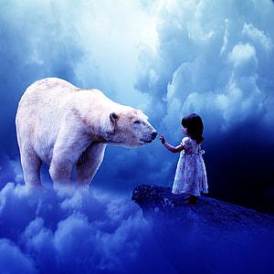 girl on cliff with Polar Bear
