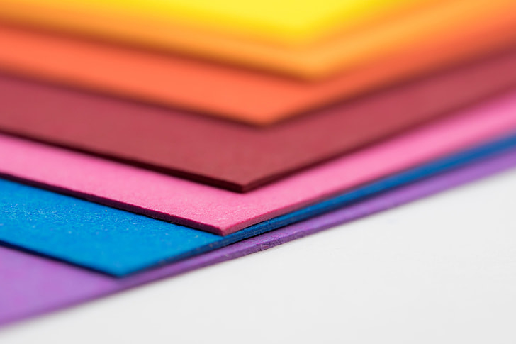 tilt shift photo of assorted-color papers