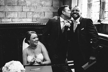 grayscale photo of bride beside groom
