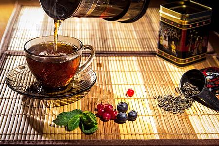 liquid poured on teacup
