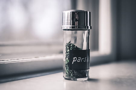 green parsley bottle on white surface