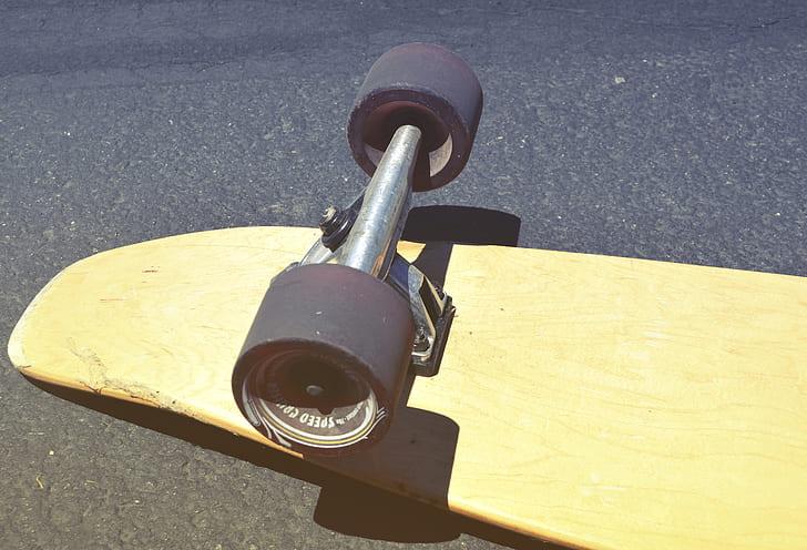 Brown Skateboard on Concrete Road