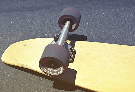 Brown Skateboard on Concrete Road