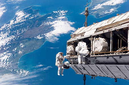 two astronaut on white space shuttle