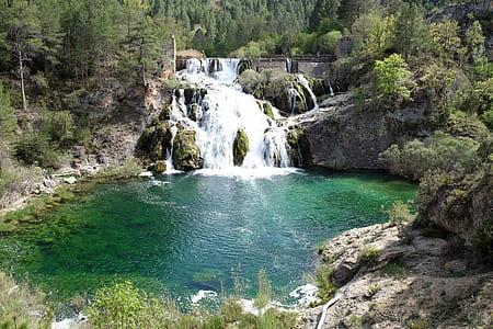 waterfalls between forest