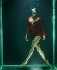 woman in red long-sleeved dress underwater