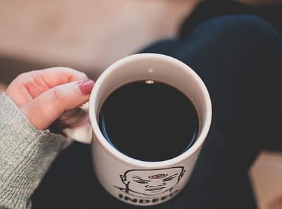 Black Beverage in White and Black Ceramic Mug