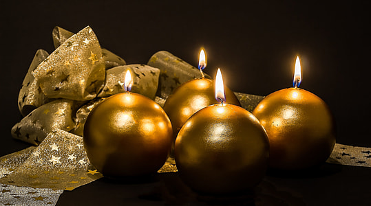 several brown candles beside ribbon