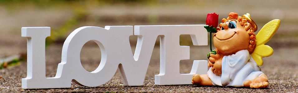 tilt lens photography of white wooden Love decoration
