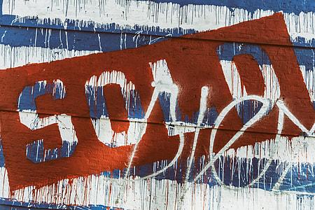 Street art captured on a city wall