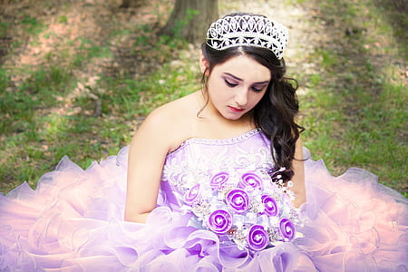 woman in purple and white floral sweetheart-neck wedding gown