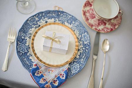 white present box on dinnerware set