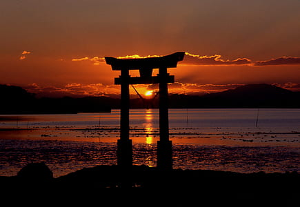 silhouette scenery of Japanese structure during sunset