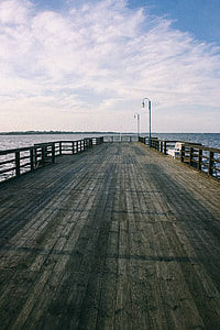Big wooden pier by the lake