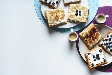 Banana and bluberries waffles with coffee espresso