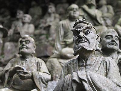 gray concrete statues