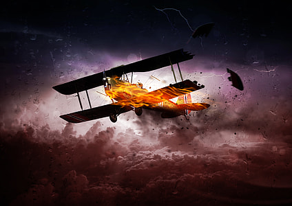 burning biplane above white and brown clouds digital wallpaper