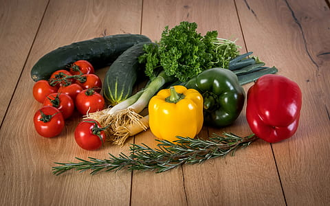 bunch of vegetables on wooden surface