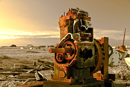 Landscape shot containing an old abandoned piece of machinery captured at sunset on the coast at Dungeness, Kent, England