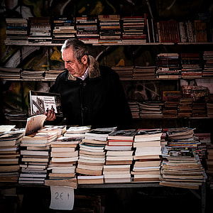 man holding book inside library