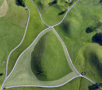 high angle photo of green lawn grasses and roads during daytime