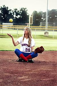 girl holding brown baseball glove