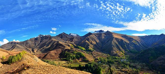 landscape photography of mountain range under cirrus clouds