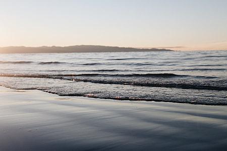 ocean waves across mountain