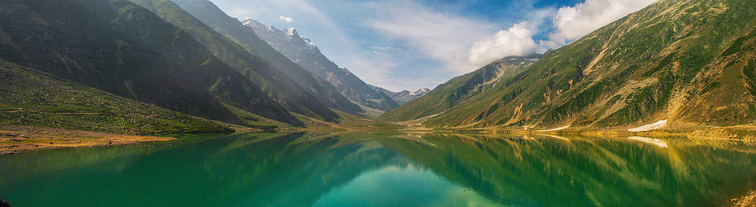 Green Lake Surrounded by Mountain