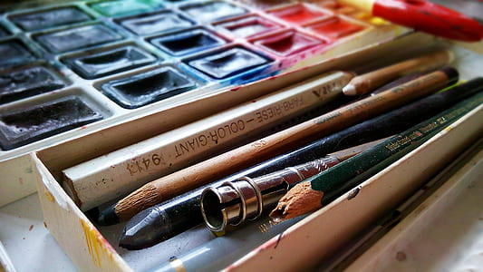 assorted-color pencils on case